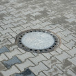 Sewer manhole in pavement — Stock fotografie #40533219
