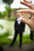 Wedding rings in hand — Stock Photo