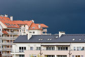 Block of flats on the background of dark sky — Stock Photo
