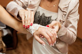 Dressing the bridal jewelry by panne young — Stock Photo