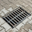 Sewer drain on the sidewalk in the city — Stock Photo #42563465