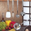 Kitchen utensils hanging — Stock Photo #29184517