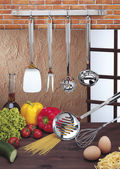 Kitchen utensils hanging — Stock Photo