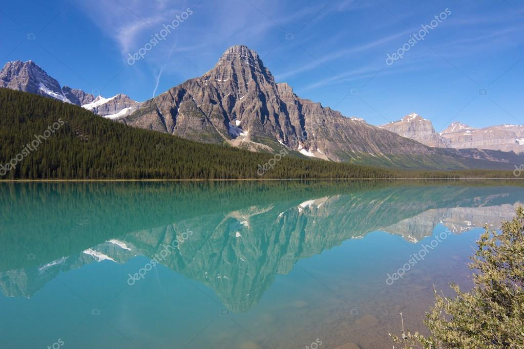 View on Hector Lake with a mountain reflecting in the quiet waters  Stock Photo #19084903