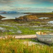 Stock Photo: Old boat at the fjord HDR