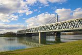 Steel bridge across a river — Stock Photo