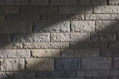 Sunbeam on a stone wall — Stock Photo