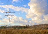 Transmission tower on a meadow — Zdjęcie stockowe