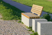 Modern bench on a dike — Stock fotografie
