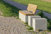 Bench on a dike — Stock Photo