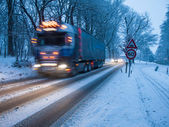 Heavy goods vehicle in a snowstorm — Stock Photo
