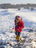 Girl pulling sledge — Stock Photo