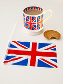 British flag with tea and biscuits — Stock Photo