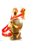 Sleigh bell with red ribbon bow — Stock Photo