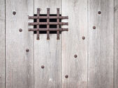 Aged wooden door with ironwork — Stock Photo