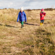 Small children walking in a dune landscape — Stock Photo