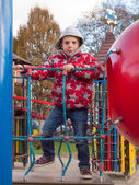 Small boy on a climbing frame — Stock Photo
