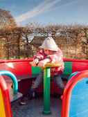 Small boy spins a roundabout — Stock Photo