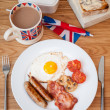 Stock Photo: Cooked english breakfast on wooden table