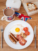 Cooked english breakfast on a wooden table — Stock Photo