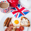 Stock Photo: Bacon, eggs and sausages with cup of tea, teapot, toast and bri