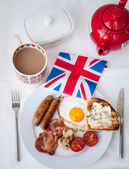 English Breakfast with cup of tea, toast and british flag — Stock Photo