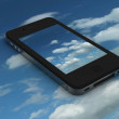 Stock Photo: Black iPhone with sky background