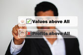 Male Professional Choosing give priority to values against profit by Clicking on the bright White Button — Stock Photo