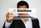 Male Professional Choosing solutions option against problems by Clicking on a White Button — Stock Photo