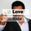Male Professional Choosing love against Hate Option by clicking on a big white button — Stock Photo