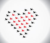 Black and red Swans flying or Geese flying or Crane Flying in the shape of heart against a white gradient sky background — Stock Photo