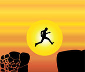 Concept design vector illustration art of young fit man jumping from a crumbing mountain rock to another safer rock on a bright orange morning or evening sky and yellow sun in the background — Stock Photo