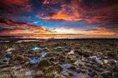 Batu Luang KUala Penyu sunset with green stone and fire sky — Stok fotoğraf