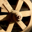 Stock Photo: Old wooden wagon wheel.