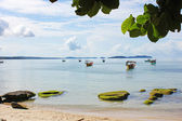 Tropical beach with boats — Stockfoto