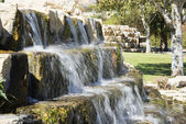 Little waterfall in a park — Stock Photo