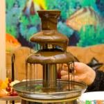 Chocolate fondue fountain — Stock Photo #18602561