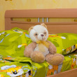 Toy teddy bear in the bed — Stock Photo