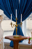 Vintage candlestick on the table — Stock Photo