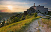 Ruin of castle with sun — Stock Photo