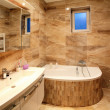 Stock Photo: Bathroom in luxury home with bath and furniture