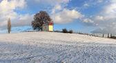 Beautiful winter landscape with chapel — Stock Photo
