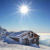 Fairy tale building in wintertime with sun - Kamenna chata — Stock Photo
