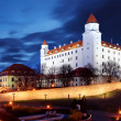 Bratislava castle from parliament at twilight with dramatic clou - Stock Photo
