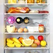 Fridge open full stocked loaded up with food and fresh ingredie — Stock Photo #19018941