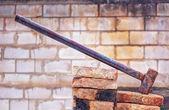Big demotition hammer with brick background — Stock Photo