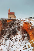 Nice Catholic Chapel in eastern Europe at winter landscape - vil — Stock Photo