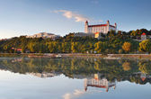 Bratislava castle with reflection in river Danube — Stock Photo