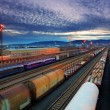 Cargo transportatio with Trains and Railways - Stock Photo