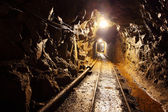 Mine with railroad track - underground mining — Stock Photo